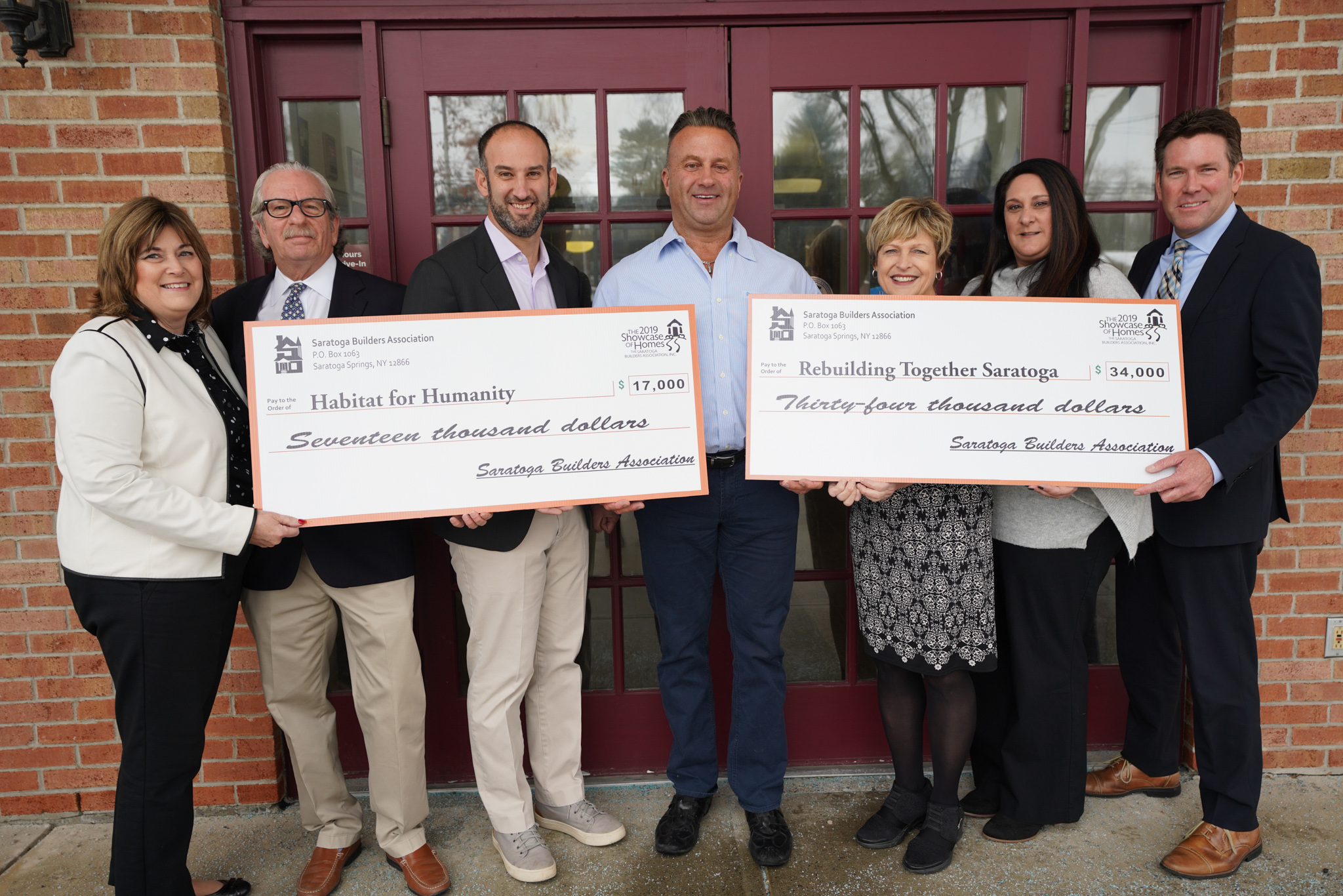 The Saratoga Builders Association is proud to present a total of $51,000 to our local charities from the proceeds of the 2019 Saratoga Showcase of Homes. From left to right: Martha McQuigge, Vice President – Saratoga National Bank; Barry Potoker, Executive Director & Showcase Co-Chair – Saratoga Builders Association; Adam Feldman, Executive Director – Habitat for Humanity of Northern Saratoga, Warren & Washington Counties; Dave Trojanski, Bonacio Construction & President – Saratoga Builders Association; Michelle Larkin, Executive Director - Rebuilding Together Saratoga County; Lisa Licata, Sterling Homes & Showcase Co-Chair; Mark Hogan, Vice President - Saratoga National Bank.
